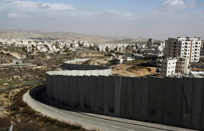 224007-section-of-controversial-israeli-barrier-is-seen-between-shuafat-refug.jpg